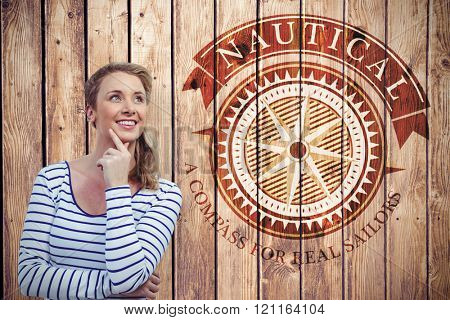Pretty girl thinking against wooden planks background