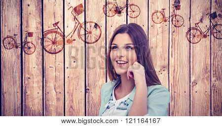 Smiling woman posing on white background against wooden planks background
