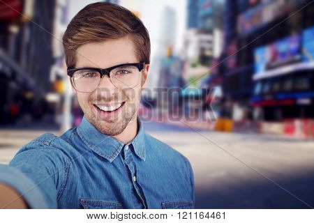 Portrait of happy man wearing eye glasses against blurry new york street