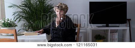 Widow sitting alone