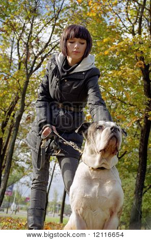 young woman and strong dog poster