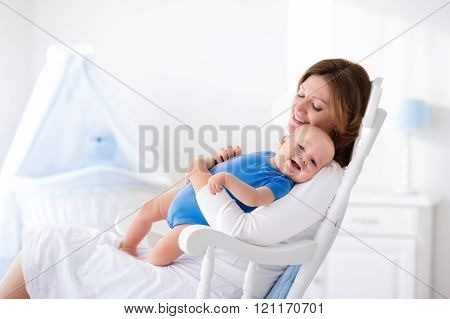 Happy Young Mother With Baby Boy At Home