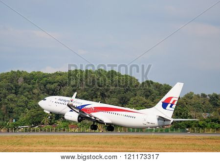 Malaysia Airlines Boeing 737 - 800 takes off at Kota Kinabalu International airport Sabah Borneo