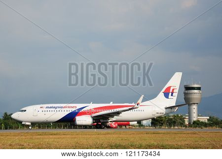 Malaysia Airlines Boeing 737-800 taxiing at Kota Kinabalu International Airport
