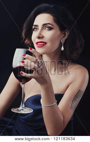 Beautiful woman holding a glass wine