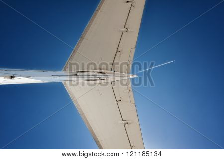 Tail of a jet airplane on sky background