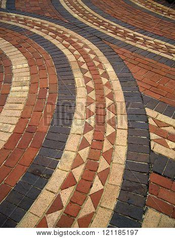 Mosaic design in brick walkway