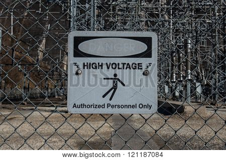 Faded High Voltage Danger Sign On Chainlink