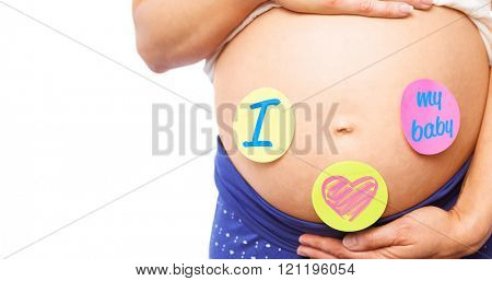 Pregnant woman with stickers on bump against i love my baby message
