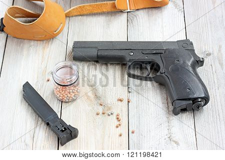 Black Pneumatic Gun On A Floor.