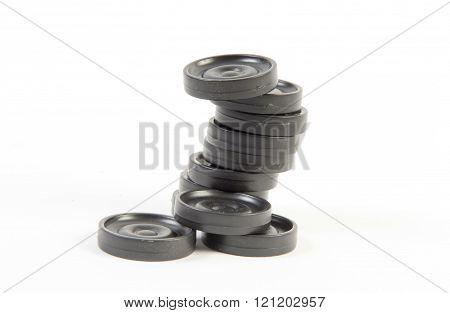 black backgammon pieces isolated on white background