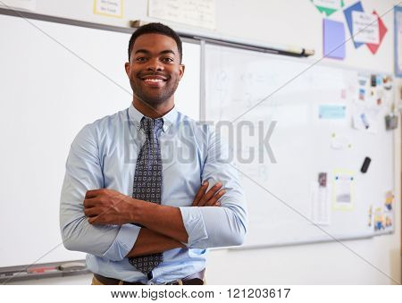 Portrait of confident African American male teacher in class