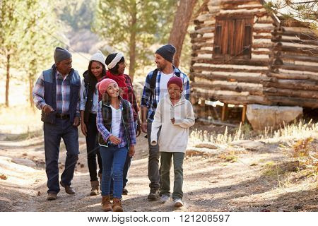 Extended Family Group On Walk Through Woods In Fall
