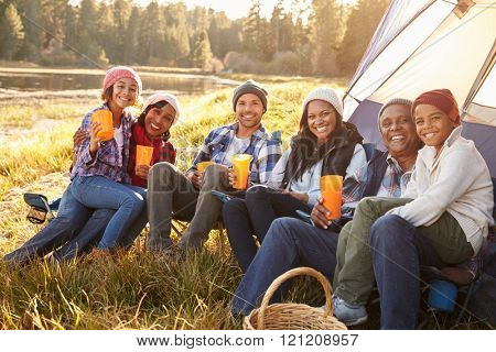 Portrait Of Extended Family Group Camping By Lake