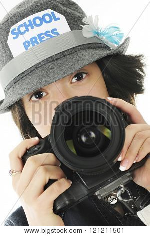 Closeup image of a pretty young teen ready to take photos for her school yearbook.  On a white background.