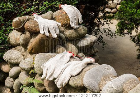Gloves Workers Were Left On A Stone Wall.