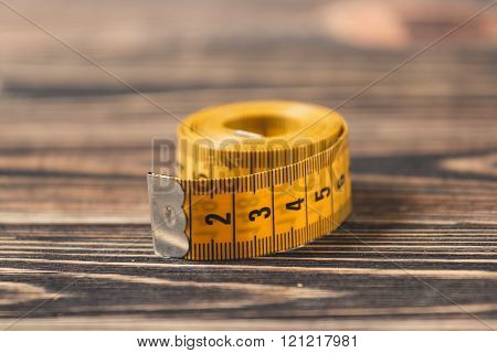Curved measuring tape.