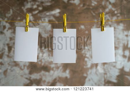 Three paper cards hanging on the rope