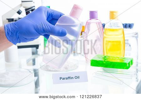 Paraffin oil. Noxious additives in cosmetics. Laboratory with chemical substances. poster