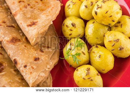 dray potato curry or potato bhaji or aalu bhaji and roti or chapati