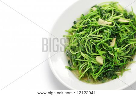 stir fried pea shoots with garlic, chinese cuisine, copy space