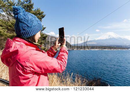 Woman taking image on mountain Fuji
