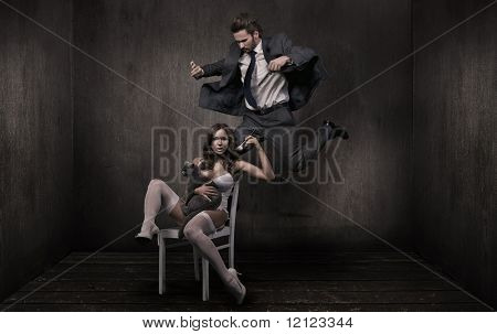 Young attractive couple and british cat in a dark room