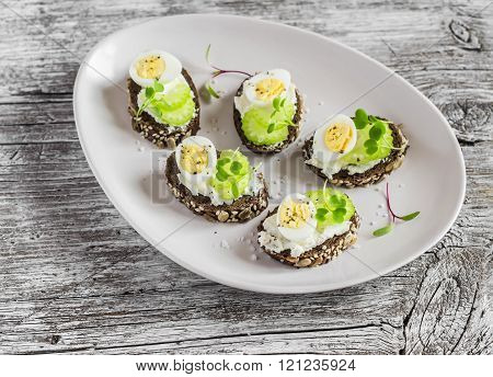 Open Sandwiches With Cream Cheese, Quail Eggs And Celery. Delicious Healthy Easter Snack Or Breakfas