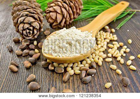 Flour cedar in wooden spoon on board