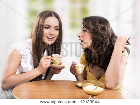 Two women enjoy a coffee break
