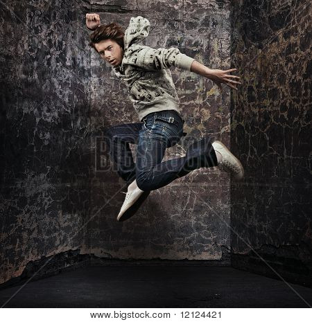 Male dancer posing over grunge wall