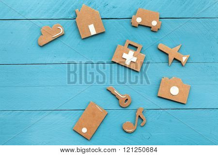 Cardboard web icons on blue background