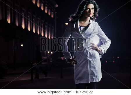 Beautiful brunette posing in the city on the night