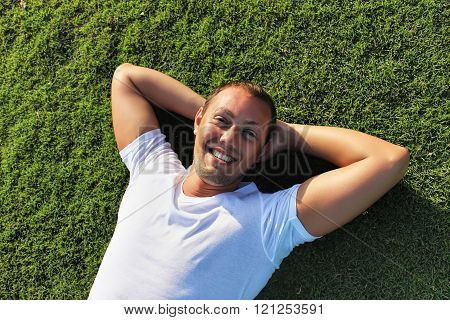 Handsome Man, Smilling, Lying On Summer, Green Grass, Relaxing Vacation