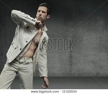 Elegant guy over grunge background