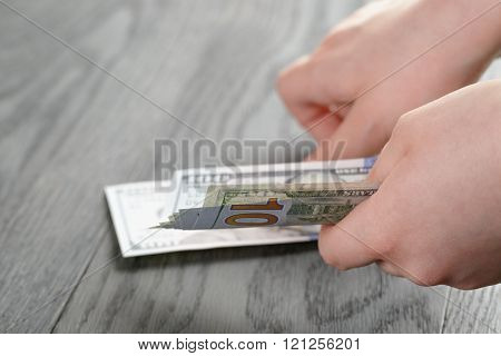 female teen hand hold dollar banknotes