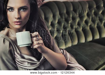 Portrait of a beautiful lady drinking afternoon coffee poster