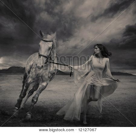 Fine art photo of a young beauty running with a horse