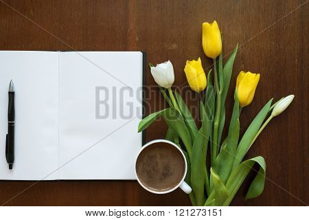 Blank book, tulips and coffee