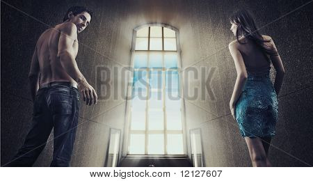 Conceptual image of a young couple stepping into the window light