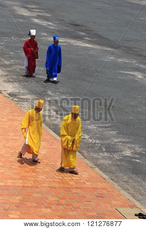 Priest Going In A Caodai Temple In Vietnam