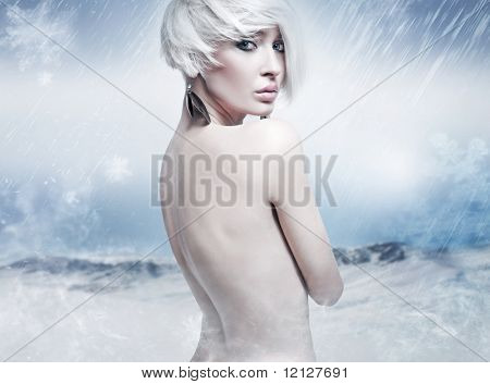 Beauty blonde in the winter scenery