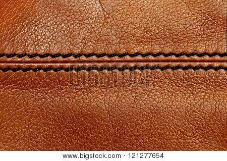 Macro brown leather with black stitching