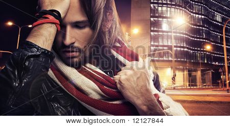 Handsome man on the city background