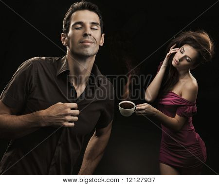 Sexy couple with cup of coffee