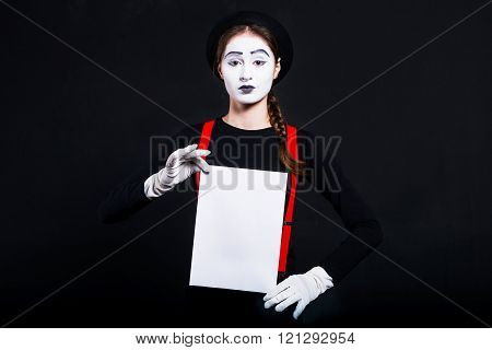 Girl Mime Holding White Sheet Of Paper
