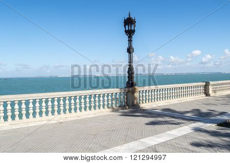 Boardwalk of Cadiz Genoves Park Andalusia Spain. Sea Sunny day and nice sky.