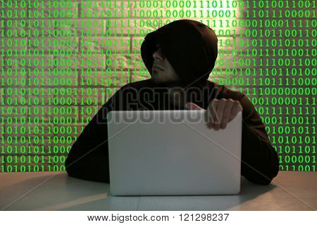 Hacker working with computer