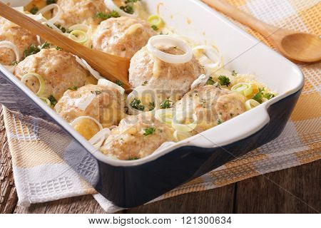 Appetizing Chicken Rissoles Baked In A Creamy Cheese Sauce Close Up