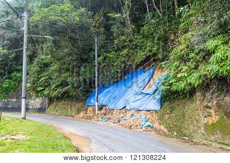 Huge plastic sheets used to temporarily halt soil erosion during rainy season